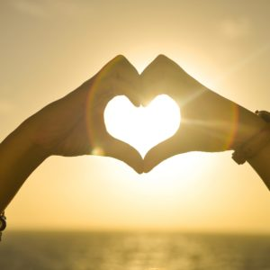 Make-a-heart-with-your-hands-at-sunset